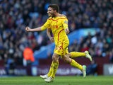 Fabio Borini of Liverpool celebrates scoring their first goal during the Barclays Premier League match between Aston Villa and Liverpool at Villa Park on January 17, 2015