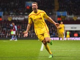Rickie Lambert of Liverpool celebrates scoring their second goal during the Barclays Premier League match between Aston Villa and Liverpool at Villa Park on January 17, 2015