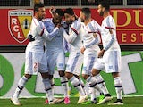 Lyon's French forward Alexandre Lacazette is congratulated by teammates after scoring during the French L1 football match Lens vs Olympique Lyonnais on January 17, 2015