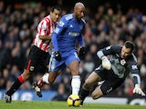 Nicolas Anelka of Chelsea goes round Marton Fulop of Sunderland to score the opening goal during the Barclays Premier League match on January 16, 2010