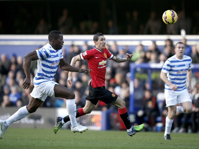 Manchester United's Argentinian midfielder Angel Di Maria and Queens Park Rangers' English defender Nedum Onuoha run after the ball during the English Premier League football match between Queens Park Rangers and Manchester United at Loftus Road Stadium i