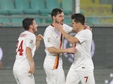 AS Roma's forward Mattia Destro is congratulated by teammates after scoring during the Italian Serie A football match Palermo vs AS Roma on January 17, 2015