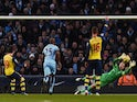 Arsenal's Spanish midfielder Santi Cazorla (L) scores the opening goal from the penalty spot past a diving Manchester City's English goalkeeper Joe Hart (2R) during the English Premier League match on January 18, 2015