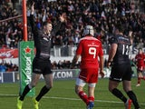 Chris Ashton of Saracens celebrates scoring a try during the European Rugby Champions Cup pool one match between Saracens and Munster at Allianz Park on January 17, 2015