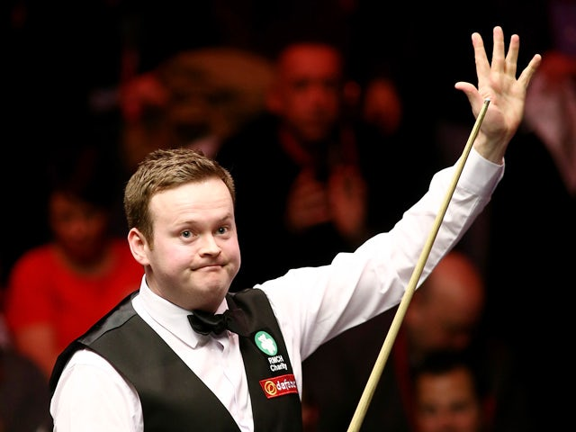 Shaun Murphy of Great Britain celebrates after winning his semi-final match against Mark Allen of Great Britain on day seven of the 2015 Dafabet Masters at Alexandra Palace on January 17, 2015