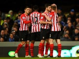 Shane Long of Southampton celebrates with team-mates after scoring the opening goal during the FA Cup third round replay match between Ipswich Town and Southampton at Portman Road on January 14, 2015