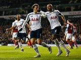Vlad Chiriches of Spurs (6) celebrates with team mate Younes Kaboul as he scores their third goal during the FA Cup Third Round Replay match between Tottenham Hotspur and Burnley at White Hart Lane on January 14, 2015