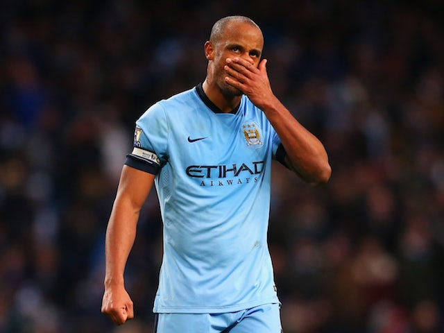 Vincent Kompany of Manchester City looks depsondent during the Barclays Premier League match against Arsenal at Etihad Stadium on January 18, 2015