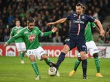 Paris Saint-Germain's Swedish midfielder Zlatan Ibrahimovic (R) vies with Saintt-Etienne's French defender Loïc Perrin during the French Ligue Cup football match on January 13, 2015