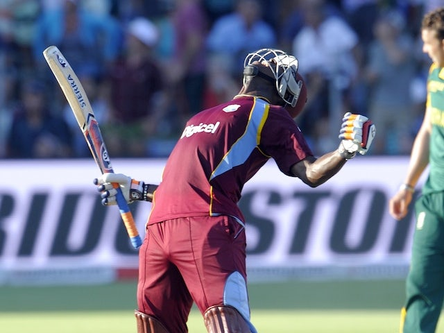 West Indies batsman Andre Russell (L) celebrates after the West Indies won the match by one wicket during the 4th One Day International cricket match on January 25, 2015