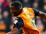 Benik Afobe of Wolverhampton Wanderers beats the challenge from Andre Bikey of Charlton Athletic during the Sky Bet Championship match on January 24, 2015