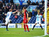 Chris Taylor of Blackburn Rovers celebrates as he scores their first and equalising goal with Marcus Olsson as goalkeeper Lukasz Fabianski of Swansea City looks dejected during the FA Cup Fourth Round match between Blackburn Rovers and Swansea City at Ewo