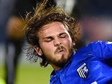 Bradley Dack of Gillingham tackles Mehdi Abeid of Newcastle United during the Capital One Cup second round match on January 24, 2015