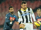 Udinese's player Cyril Thereau vies with Napoli player Miguel Britos during the TIM CUP match on January 22, 2015