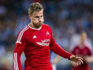David Goodwillie of Aberdeen FC controls the ball during the UEFA Europa League third round qualifying first leg match against Real Sociedad on August 12, 2014
