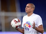 French foward David Trezeguet stands during the inter religious 'match for peace' football game in Rome's Olympic Stadium on September 1, 2014