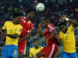 Congo's midfielder Delvin Ndinga (2ndL) heads the ball next to Gabon's defender Bruno Ecuele during the 2015 African Cup of Nations group A football match on January 21, 2015