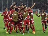 Equatorial Guinea's players celebrate after scoring a goal during the 2015 African Cup of Nations group A football match between Gabon and Equatorial Guinea, on January 25, 2015