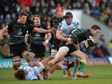 George North of Northampton Saints escapes a tackle by Antonie Claassen of Racing Metro 92 during the European Rugby Champions Cup match on January 24, 2015