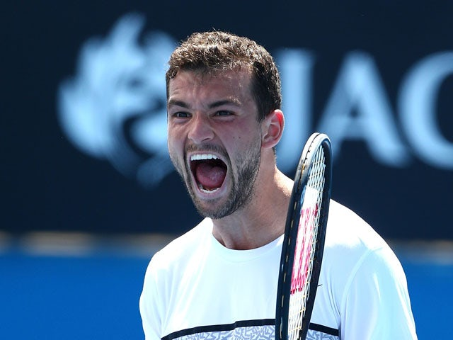 Grigor Dimitrov of Bulgaria celebrates winning his third round match against Marcos Baghdatis of Cyprus during day five of the 2015 Australian Open at Melbourne Park on January 23, 2015