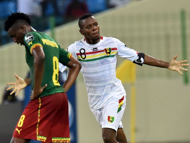 0d8b6afe031 Guinea's midfielder Ibrahima Traore celebrates after scoring a goal during  the 2015 African Cup of Nations