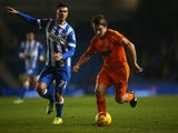 Jay Tabb of Ipswich Town is chased by Danny Holla of Brighton and Hove Albion during the Sky Bet Championship match on January 21, 2015