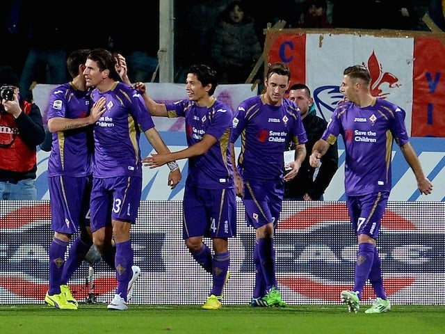 Fiorentina's German forward Mario Gomez celebrates after scoring during the Serie A football match Fiorentina vs AS Roma at Artemio Franchi stadium in Florence on January 25, 2015