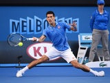 Serbia's Novak Djokovic plays a shot during his men's singles match against Spain's Fernando Verdasco on day six of the 2015 Australian Open tennis tournament in Melbourne on January 24, 2015