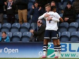 Paul Gallagher of Preston North End celebrates the opening goal with team mate Chris Humphrey during the FA Cup Fourth Round match between Preston North End and Sheffield United at Deepdale on January 24, 2015