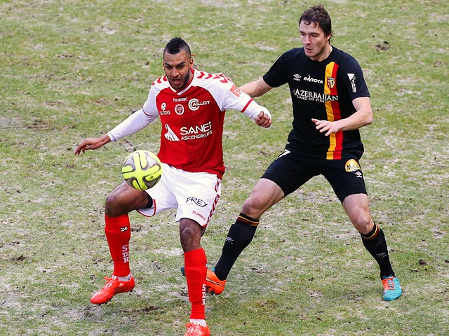 Reims' French forward David Ngog vies for the ball with Lens' defender Benjamin Boulenger during the French L1 football match between Reim and Lens, on January 25, 2015