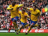 Richard Pacquette of Havant (L) celebrates with team mates his opening goal during the FA Cup 4th round match against Liverpool on January 26, 2008