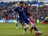 Scott Malone of Cardiff holds off pressure from Chris Gunter of Reading during the FA Cup Fourth Round match on January 24, 2015