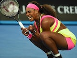 Serena Williams squats with pleasure after winning her first-round encounter at the Australian Open on January 20, 2015
