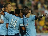 Bernie Ibini-Isei of Sydney FC points to the Mariners crowd after his team scores a goal during the round 16 A-League match between the Central Coast Mariners and Sydney FC at Central Coast Stadium on January 24, 2015