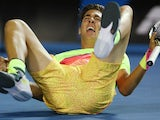 Australia's Thanasi Kokkinakis drops to the ground in disbelief after ousting Ernests Gulbis in the first round of the Australian Open on January 19, 2015