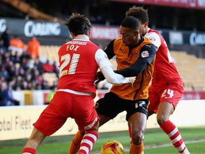 Rajiv van La Parra of Wolverhampton Wanderers is tackled by Morgan Fox and Jordan Cousins of Charlton Athletic during the Sky Bet Championship match between Wolverhampton Wanderers and Charlton Athletic at Molineux on January 24, 2015