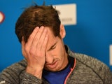 Britain's Andy Murray gestures as he addresses a press conference after defeat in his men's singles final match against Serbia's Novak Djokovic on day fourteen of the 2015 Australian Open on February 1, 2015