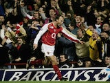 Dennis Bergkamp of Arsenal celebrates by pointing at the photographers after scoring their second goal of the game during the Barclays Premiership match between Arsenal and Manchester United at Highbury on February 1, 2005