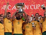 Australia's captain Mile Jedinak holds up the AFC Asian Cup football trophy after beating South Korea at Stadium Australia in Sydney on January 31, 2015