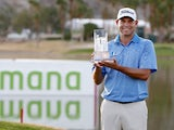 Bill Haas of the United States poses with the trophy after winning the final round of the Humana Challenge in partnership with The Clinton Foundation on the Arnold Palmer Private Course at PGA West on January 25, 2015