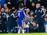 Cesc Fabregas of Chelsea high fives Jose Mourinho manager of Chelsea as he is replaced during the Capital One Cup Semi-Final second leg against Liverpool on January 27, 2015