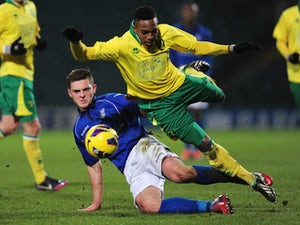Charlee Adams of Birmingham City tackles Reece Hall-Johnson of Norwich City during the FA Youth Cup 5th round match between Norwich City U18's and Birmingham City U18's at Carrow Road on February 26, 2013