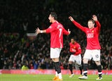 Manchester United's Portugese midfielder Cristiano Ronaldo (L) celebrates with English forward Wayne Rooney after scoring his second goal against Portsmouth on January 30, 2008