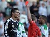 Real Madrid's Portuguese forward Cristiano Ronaldo (L) is handed a red card during the Spanish league football match Cordoba CF vs Real Madrid CF at the Nuevo Arcangel stadium on January 24, 2015