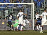 Daniele Dessena #16 of Cagliari Calcio scores their first goal during the Serie A match against Atalanta BC on February 1, 2015