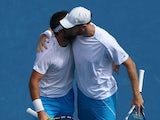 Dominic Inglot of Great Britain and Florin Mergea of Romania in action in their third round doubles match against Bob Bryan of the United States and Mike Bryan of the United States during day eight of the 2015 Australian Open at Melbourne Park on January
