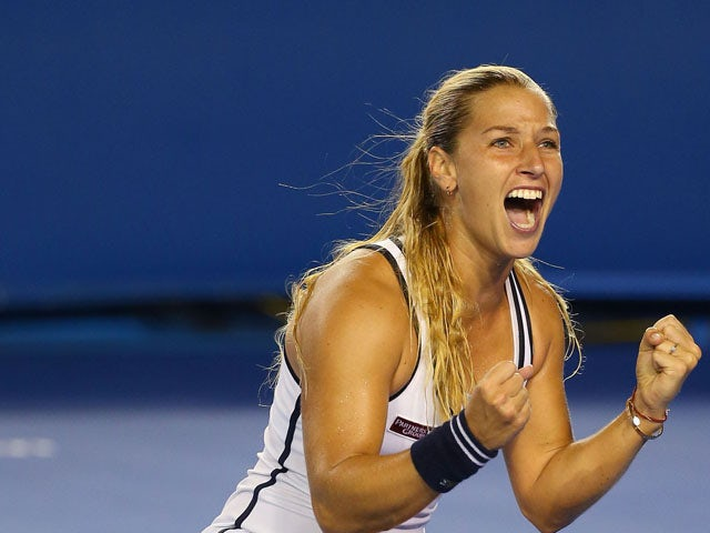 Dominika Cibulkova of Slovakia celebrates winning her fourth round match against Victoria Azarenka of Belarus during day eight of the 2015 Australian Open at Melbourne Park on January 26, 2015
