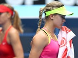 Eugenie Bouchard of Canada wipes her face as Maria Sharapova of Russia looks on in her quarterfinal match during day nine of the 2015 Australian Open at Melbourne Park on January 27, 2015