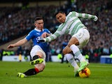 Fraser Aird of Rangers tackles Emilio Izaguirre of Celtic during the Scottish League Cup Semi-Final between Celtic and Rangers at Hampden Park on February 1, 2015
