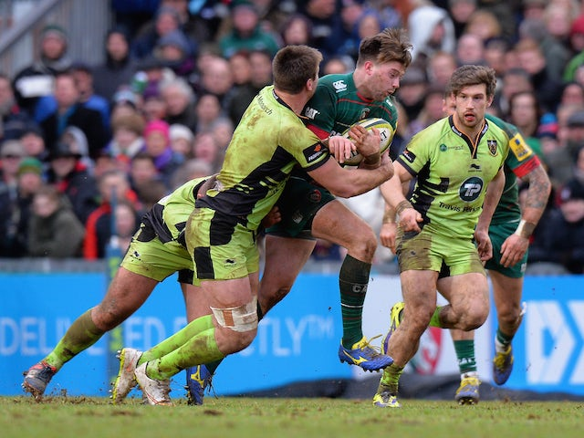 George Catchpole of Leicester Tigers is tackled by Cam Dolan of Northampton Saints during the LV= Cup match on January 31, 2015